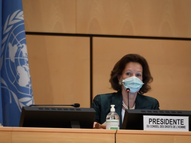 The president of the Human Rights Council, Austrian Ambassador Elisabeth Tichy-Fisslberger, wearing a protective face mask is seen during the resuming of a UN Human Rights Council session after it interruption in March over the coronavirus pandemic on June 15, 2020 in Geneva. - The UN's top rights body Monday …