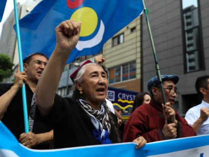 OSAKA, JAPAN - JUNE 29: Rebiya Kadeer, president of the World Uyghur Congress (WUC) (L) and people chant slogans and wave flags during a protest march on June 29, 2019 in Osaka, Japan. U.S. President Donald Trump and Chinese President Xi Jinping agreed to resume trade negotiations on Saturday during …