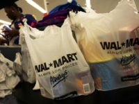 Shopping bags lie on a checkout counter of a Wal-Mart Supercenter May 11, 2005 in Troy, Ohio. Wal-Mart, America's largest retailer and the largest company in the world based on revenue, has evolved into a giant economic force for the U.S. economy. With growth, the company continues to weather criticism …