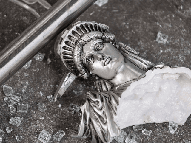 A broken Statue of Liberty figure is seen between glass shatters outside a looted souvenir shop after a night of protest over the death of an African-American man George Floyd in Minneapolis on June 2, 2020 in Manhattan in New York City