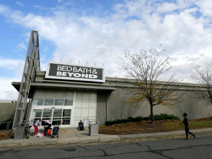FILE - In this Oct. 25, 2017, file photo, shoppers stand outside of a Bed Bath & Beyond department store at Jersey Gardens Mall in Elizabeth, N.J. Six senior executives at Bed Bath & Beyond are leaving the company as part of an extensive restructuring as the retailer tries to …