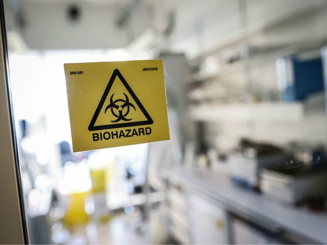 A picture taken in a laboratory of the National Reference Center (CNR) for respiratory viruses at the Institut Pasteur in Paris on January 28, 2020 shows a biohazard sticker on the entrance of a room. - The CNR analyses the tests for respiratory viruses among which coronavirus. The deadly new …