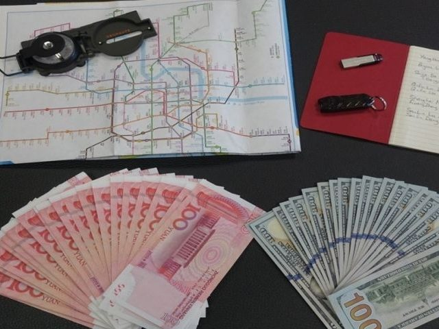 The article said a compass, a USB stick, a notebook, a map of Shanghai and cash were among several items seized in the operation.(Global Times)