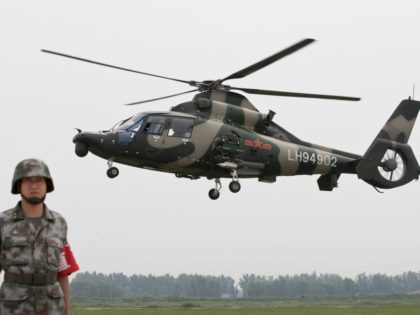Chinese Army Z-9WZ attack helicopter, designed and manufactured by China, fly over during a demonstration for press at a base of Chinese People's Liberation Army (PLA) Army Aviation 4th Helicopter Regiment, ahead of Army Day on Aug. 1, on the outskirts of Beijing, China Tuesday, July 24, 2012. (AP Photo/Andy …