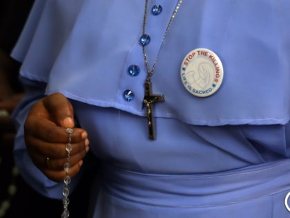 A Catholic faithful holding a rosary attends a march on the streets of Abuja during a prayer and penance for peace and security in Nigeria in Abuja on March 1, 2020. - The Catholic Bishops of Nigeria gathered faithfuls as well as other Christians and other people to pray for …