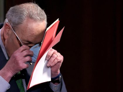 WASHINGTON, DC - JUNE 09: Senate Minority Leader Chuck Schumer (D-NY) puts on a face mask after speaking at a press conference June 09, 2020 in Washington, DC. Schumer and Sen. Mazie Hirono (D-HI) answered questions related to reforming law enforcement policies in the wake of the death of George …