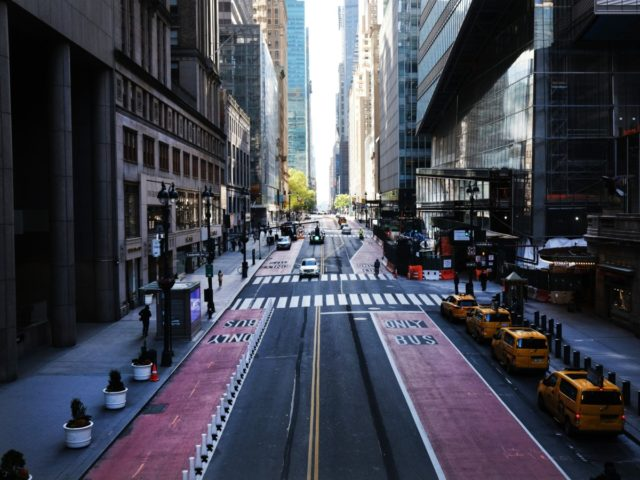 NEW YORK CITY- MAY 12: Usually one of the most congested streets in Manhattan, 42nd Street stands nearly empty on May 12, 2020 in New York City. Across America, people are reeling from the loss of jobs and incomes as unemployment soars to historical levels following the COVID-19 outbreak. While …