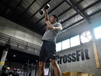 A gym enthusiast exercised whilst maintaining distance from others at CrossFit Arena Bangkok, during their first week of reopening following closure of physical wellness centers after authorities lifted some measures of restrictions to halt the spread of the COVID-19 coronavirus in Bangkok on May 20, 2020. (Photo by Lillian SUWANRUMPHA …
