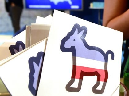 Paddles with the Donkey logo are seen at the Facebook section ahead of the Democratic presidential debate at the Wynn Hotel in Las Vegas, Nevada on October 13, 2015, hours before the first Democratic Presidential Debate. After ignoring her chief rival for months, White House heavyweight contender Hillary Clinton steps …