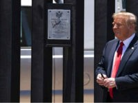 President Donald Trump smiles after autographing a section of the border wall during a tour, Tuesday, June 23, 2020, in San Luis, Ariz. (AP Photo/Evan Vucci)