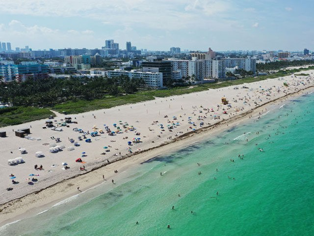 MIAMI BEACH, FLORIDA - JUNE 10: An aerial drone view as beachgoers take advantage of the opening of South Beach on June 10, 2020 in Miami Beach, Florida. Miami-Dade county and the City of Miami opened their beaches today as the area eases restrictions put in place to contain COVID-19. …