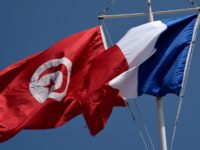 French and Tunisian flags float during a ceremony to mark the 71th anniversary of the end of World War II, on May 8, 2016 at the Gammarth french military cemetary in Tunis. / AFP / FETHI BELAID (Photo credit should read FETHI BELAID/AFP via Getty Images)