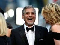 """CANNES, FRANCE - MAY 12: Actress Julia Robert and actor George Clooney attend the """"Money Monster"""" premiere during the 69th annual Cannes Film Festival at the Palais des Festivals on May 12, 2016 in Cannes, France. (Photo by Pascal Le Segretain/Getty Images)"""