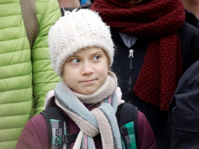 "Swedish teen climate activist Greta Thunberg takes part in a ""Fridays for future"" protest over climate emergency on February 21, 2020 in Hamburg, northern Germany. (Photo by MORRIS MAC MATZEN / AFP) (Photo by MORRIS MAC MATZEN/AFP via Getty Images)"
