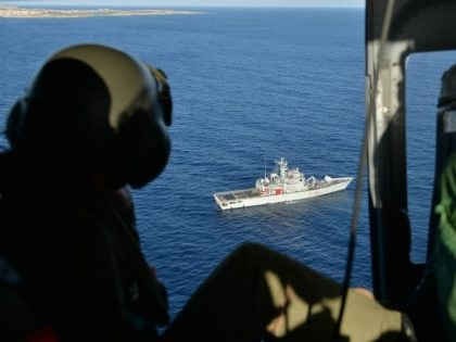 LAMPEDUSA, ITALY - OCTOBER 09: Images taken from a AB412 helicopter with the Second Regiment SIRIO of the Italian Army show Italian Navy ships and the Coast Guard units taking part in a search and rescue operation near the coast of the Italian island of Lampedusa for the victims of …