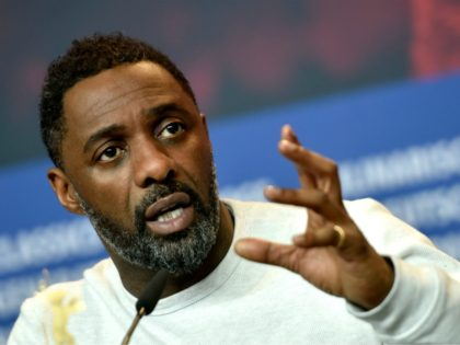 "British actor, director and executive producer Idris Elba speaks during a press conference to present the film ""Yardie"" shown in the ""Panorama Special"" category during the 68th edition of the Berlinale film festival in Berlin on February 22, 2018. / AFP PHOTO / Stefanie Loos (Photo credit should read STEFANIE …"