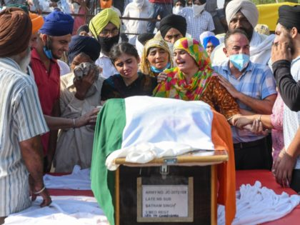 Wife Jaswinder Kaur (4R), her daughter Sandeep Kaur (4L), her son Prabhjot Singh (2R), father Jagir Singh (3L), mother Kashmir Kaur (C) of soldier Satnam Singh who was was killed in a recent clash with Chinese forces in the Galwan valley area, during the cremation ceremony at Bhojraj village near …