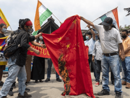 Exile Tibetans and local Indians burn a Chinese national flag during a protest in Dharmsala, India, Friday, June 19, 2020. India said Thursday it was using diplomatic channels with China to de-escalate a military standoff in a remote Himalayan border region where 20 Indian soldiers were killed this week. (AP …