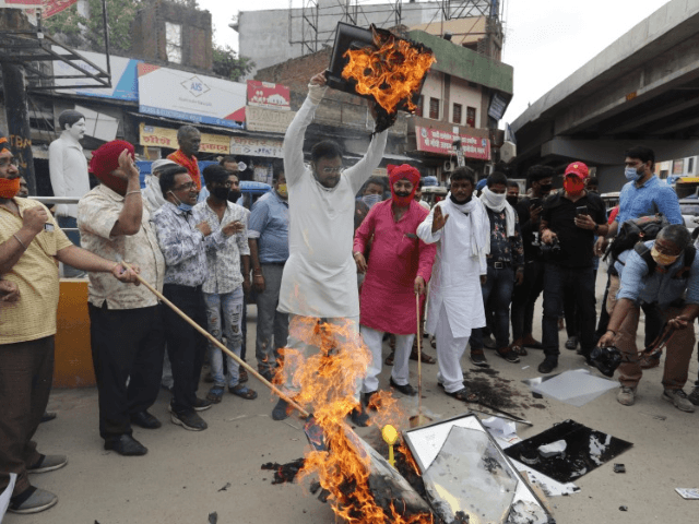 Indians burn products made in China during a protest against the Chinese government in Lucknow, India, Wednesday, June 17, 2020. India and China sought Wednesday to de-escalate tensions following a fatal clash along a disputed border high in the Himalayas that left 20 Indian soldiers dead. The skirmish Monday in …