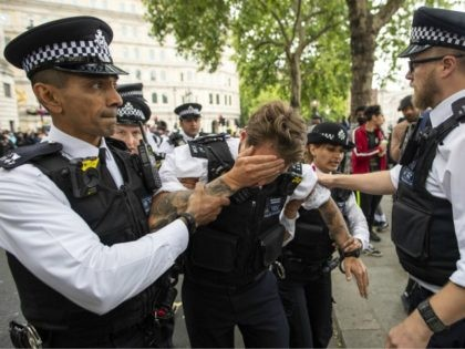 LONDON, ENGLAND - JUNE 03: An injured police officer, who appeared to have been struck in the head by a thrown object, is assisted by his colleagues during a Black Lives Matter protest at Trafalgar Square June 03, 2020 in London, England. The death of an African-American man, George Floyd, …