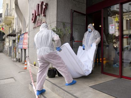 Forensic workers carry the body of Gholamreza Mansouri from a hotel downtown Bucharest, Romania, Friday, June 19, 2020. Mansouri, a former judge from Iran sought by his country to face corruption charges has died after falling from a high floor inside a hotel. Romanian police said only that a man …