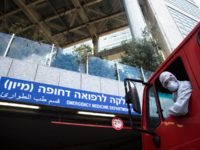 TEL AVIV, ISRAEL - MARCH 20: An Israeli Fire Department crew man drives a fire truck before spraying disinfctants to sanitize the entrance to Tel Aviv's Hospital Emergency Department on March 20, 2020 in Tel Aviv, Israel. Number of coronavirus in Israel continues to jump, after over 200 new cases …