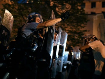 A police officer pepper sprays protesters during a demonstration at Lafayette square, in front of the White House, in Washington, DC on June 22, 2020. - A crowd of protestors tried to topple the statue of a former US president near the White House on the evening of June 22 …