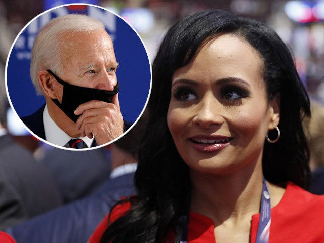 (INSET: Joe Biden) Republican Presidential Candidate Donald Trump spokeswoman Katrina Pierson talks with delegates on the convention floor during the final day of the Republican National Convention in Cleveland, Thursday, July 21, 2016. (AP Photo/Carolyn Kaster)