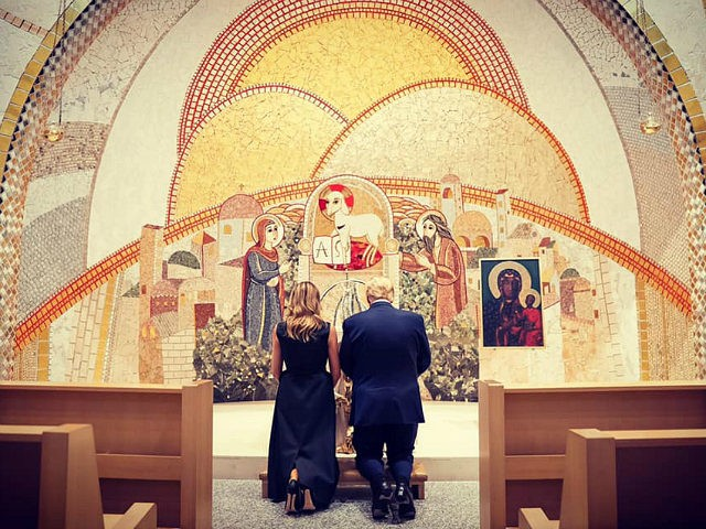 President Donald Trump and First Lady Melania Trump knelt in prayer behind the scenes during their visit to the Saint John Paul II National Shrine in Washington, DC, on Tuesday.