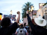 "People shout slogans and hold placards, on June 1, 2020, in downtown Las Vegas, as they take part in a ""Black lives matter"" rally in response to the recent death of George Floyd, an unarmed black man who died while in police custody. - Thousands of National Guard troops patrolled …"