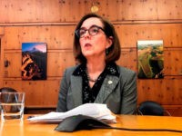 FILE - In this Monday, July 1, 2019, file photo, Oregon Gov. Kate Brown speaks with the media at the Capitol in Salem, Ore. Republican lawmakers were left fuming and justice reform advocates elated after Oregon's governor decided against calling a special session of the Legislature to have lawmakers review …