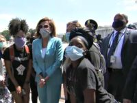 Nancy Pelosi Surrounded by Guards as She Walks Among Protesters