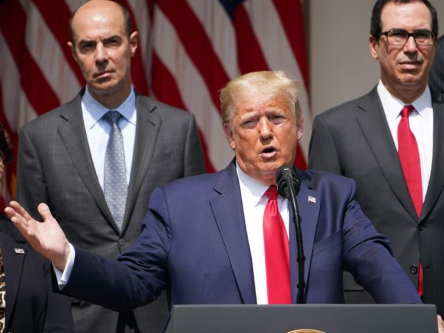 US President Donald Trump, with US Secretary of the Treasury Steven Mnuchin (R), holds a press conference on the economy, in the Rose Garden of the White House in Washington, DC, on June 5, 2020. - The US economy regained 2.5 million jobs in May as coronavirus pandemic shutdowns began …