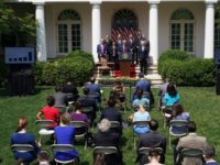 US President Donald Trump, with Director of the National Economic Council Larry Kudlow (L), holds a press conference on the economy, in the Rose Garden of the White House in Washington, DC, on June 5, 2020. - The US economy regained 2.5 million jobs in May as coronavirus pandemic shutdowns …