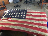 Anonymous Person Returns Historic American Flag Taken During Riots