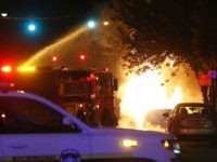 A car explodes as firefighters attempt to douse the flames as protesters march through downtown during a third night of unrest Sunday, May 31, 2020, in Richmond, Va. Gov. Ralph Northam issued a curfew for this evening. (AP Photo/Steve Helber)
