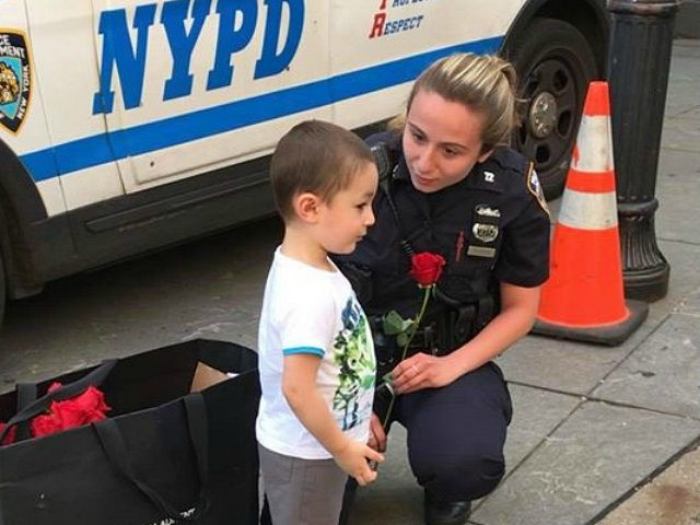 Father, Son Hand Out Roses to New York Police Officers