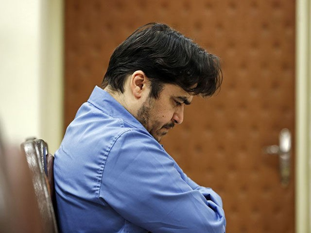 Ruhollah Zam, a former opposition figure who had lived in exile in France and had been implicated in anti-government protests, speaks during his trial at Iran's Revolutionary Court in Tehran on June 2, 2020. - Iran said it has sentenced to death Ruhollah Zam. The court has considered 13 counts …