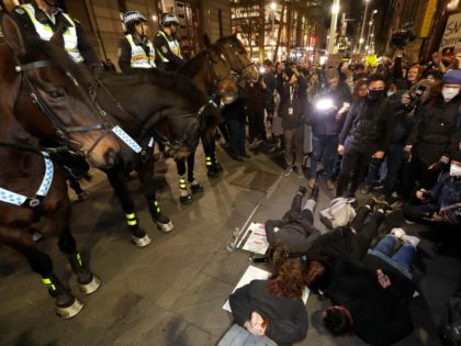 Protesters lay on the ground in front of police on horseback as they gather in Sydney, Tuesday, June 2, 2020, to support the cause of U.S. protests over the death of George Floyd and urged their own governments to address racism and police violence. Floyd died last week after he …