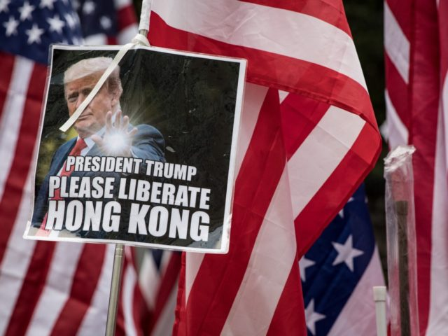 HONG KONG, CHINA - SEPTEMBER 08: Protesters hold American flags as they walk through Central district during a march to petition the US Consulate on September 08, 2019 in Hong Kong, China. Pro-democracy protesters have continued demonstrations across Hong Kong since 9 June against a controversial bill which allows extraditions …
