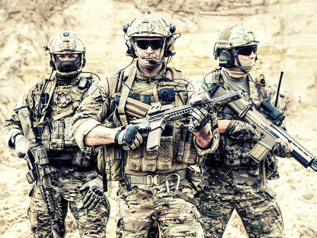 Group portrait of US army elite members, private military company servicemen, anti terrorist squad fighters standing together with guns. Brothers in arms, war conflict combatants, soldiers of fortune