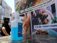 A bottle of sanitising gel stands at the entrance of restaurant in Jerusalem on May 27, 2020 as restaurants were allowed to open for the first time in months after the Israeli government approved the easing of measures put in place to stop the spread of the coronavirus Covid-19. (Photo …