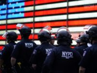 New York cop who shoved race protester to be charged