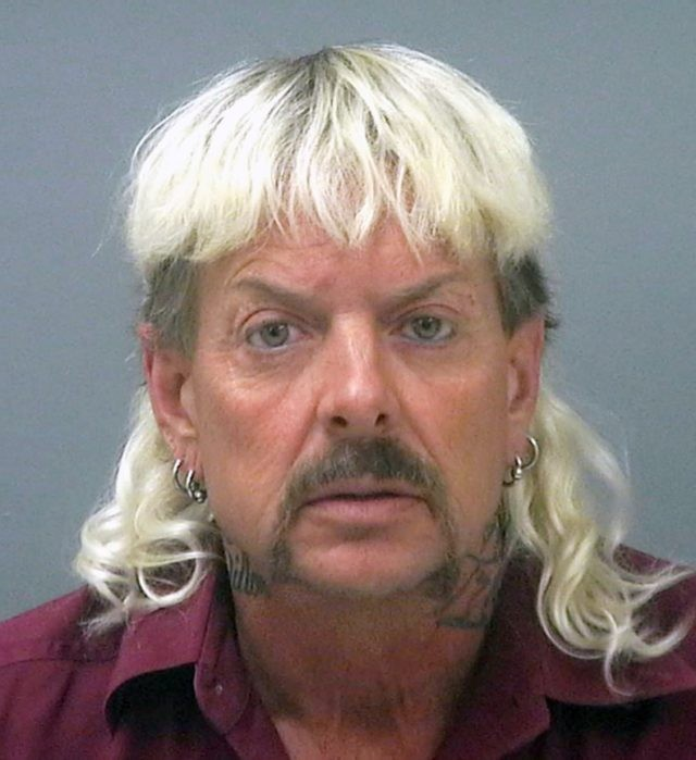 """This undated file photo provided by the Santa Rose County Jail in Milton, Fla., shows Joseph Maldonado-Passage, also known as Joe Exotic. A federal judge in Oklahoma has awarded ownership of the zoo made famous in Netflix's """"Tiger King"""" docuseries to Joe Exotic's rival, Carole Baskin. In a ruling Monday, …"""