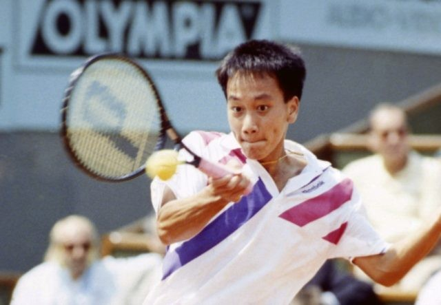 In this June 9, 1989, file photo, Michael Chang makes a return during his match against Ivan Lendl in the men's singles final at the French Open tennis championships in Paris. Chang would go on to become the youngest male champion at any Slam, beating Lendl 4-6, 4-6, 6-3, 6-3, …