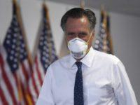 Sen. Mitt Romney, R-Utah, leaves a Republican luncheon on Capitol Hill in Washington, Thursday, June 4, 2020. (AP Photo/Susan Walsh)