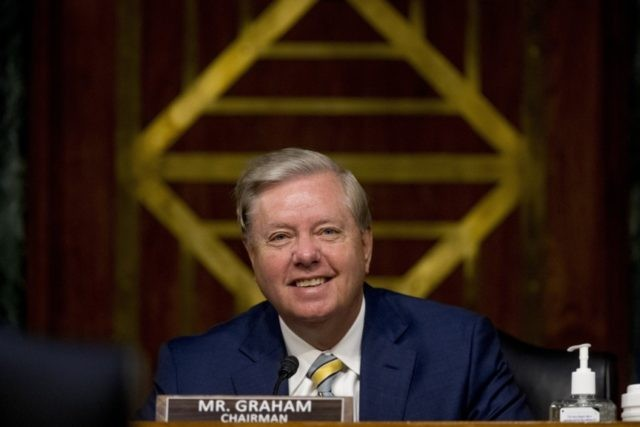 Chairman Sen. Lindsey Graham, R-S.C., smiles during a Senate Judiciary Committee hearing on Capitol Hill in Washington, Tuesday, June 9, 2020, to examine COVID-19 fraud, focusing on law enforcement's response to those exploiting the pandemic. (AP Photo/Andrew Harnik, Pool)