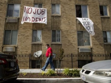 "In this May 20, 2020, file photo, signs that read ""No Job No Rent"" hang from the windows of an apartment building during the coronavirus pandemic in Northwest Washington. The pandemic has shut housing courts and prompted authorities around the U.S. to initiate policies protecting renters from eviction. But not …"