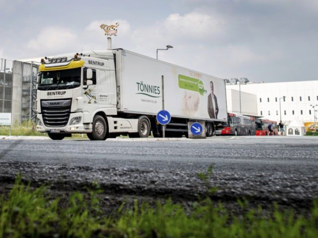 A truck leaves the Toennies meatpacking plant in Rheda-Wiedenbrueck, Germany, Wednesday, June 17, 2020. More than 400 new cases of COVID-19 have been recorded among workers at a large meatpacking plant in western Germany, authorities said Wednesday, in an outbreak that may have been linked to the easing of travel …