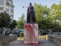 The statue of Hubert Lyautey, who served in Morocco, Algeria, Madagascar and Indochina when they were under French control, is offered with red painting Monday, June 22, 2020. Two statues related to France's colonial era were covered in graffiti Monday amid a global movement to take down monuments to figures …